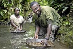 Artisanal miners panning for gold.