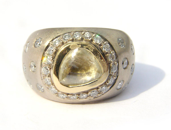 Recycled yellow gold, ethical white gold and rough, yellow diamond ring.