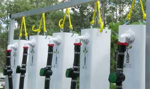 Each tower has a regulator attached to adjust nutrient drip.