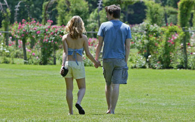 Couple Strolling on the Grass